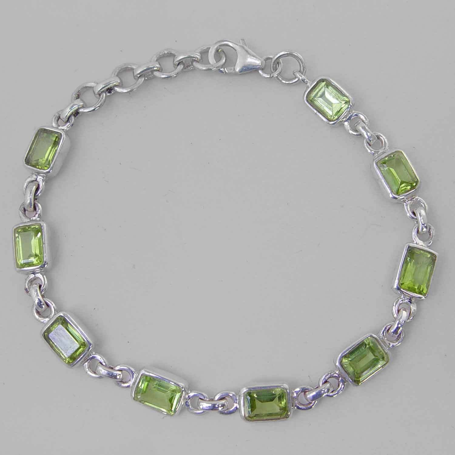 Peridot 9 Faceted Emerald Cut Sterling Silver Link Bracelet - 16 CTW