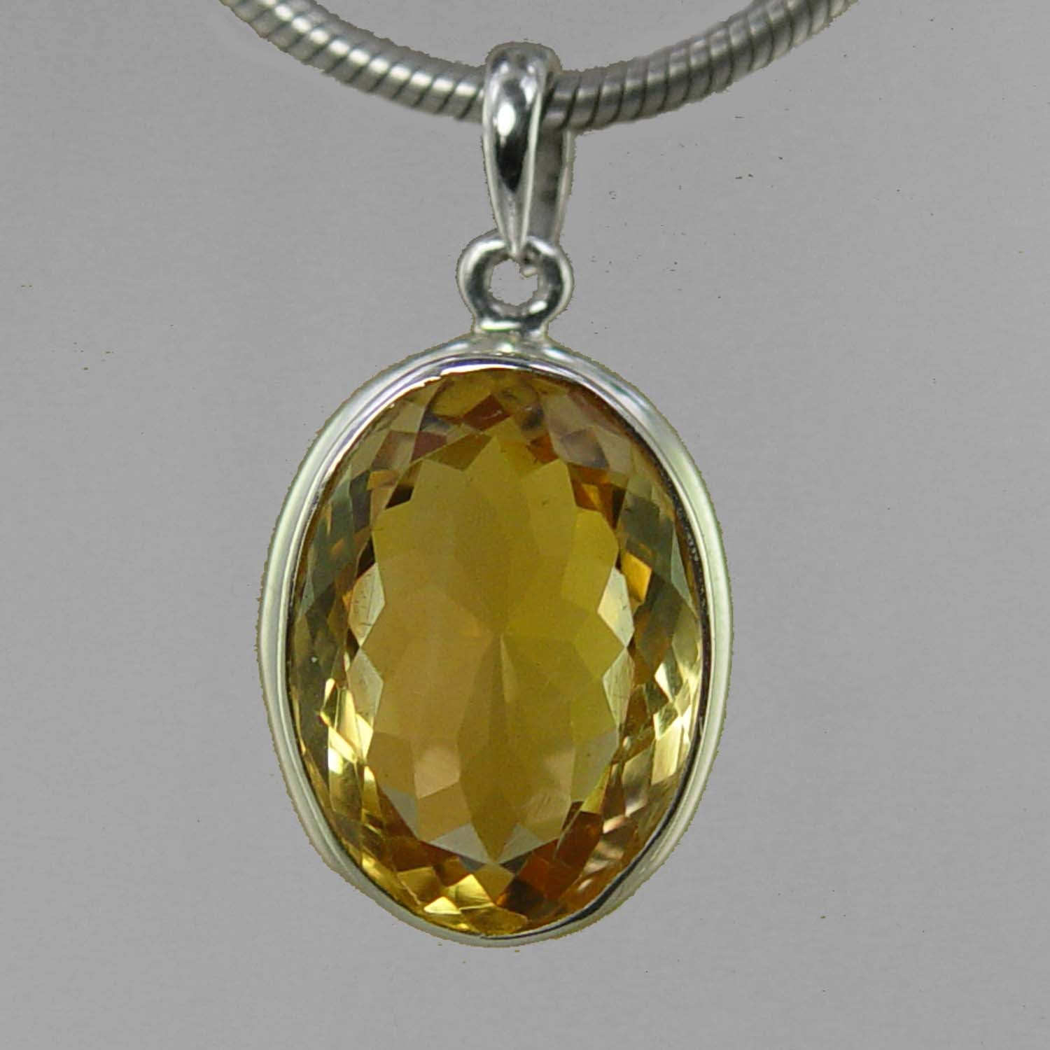 Citrine 9 ct Oval Bezel Set Sterling Silver Pendant