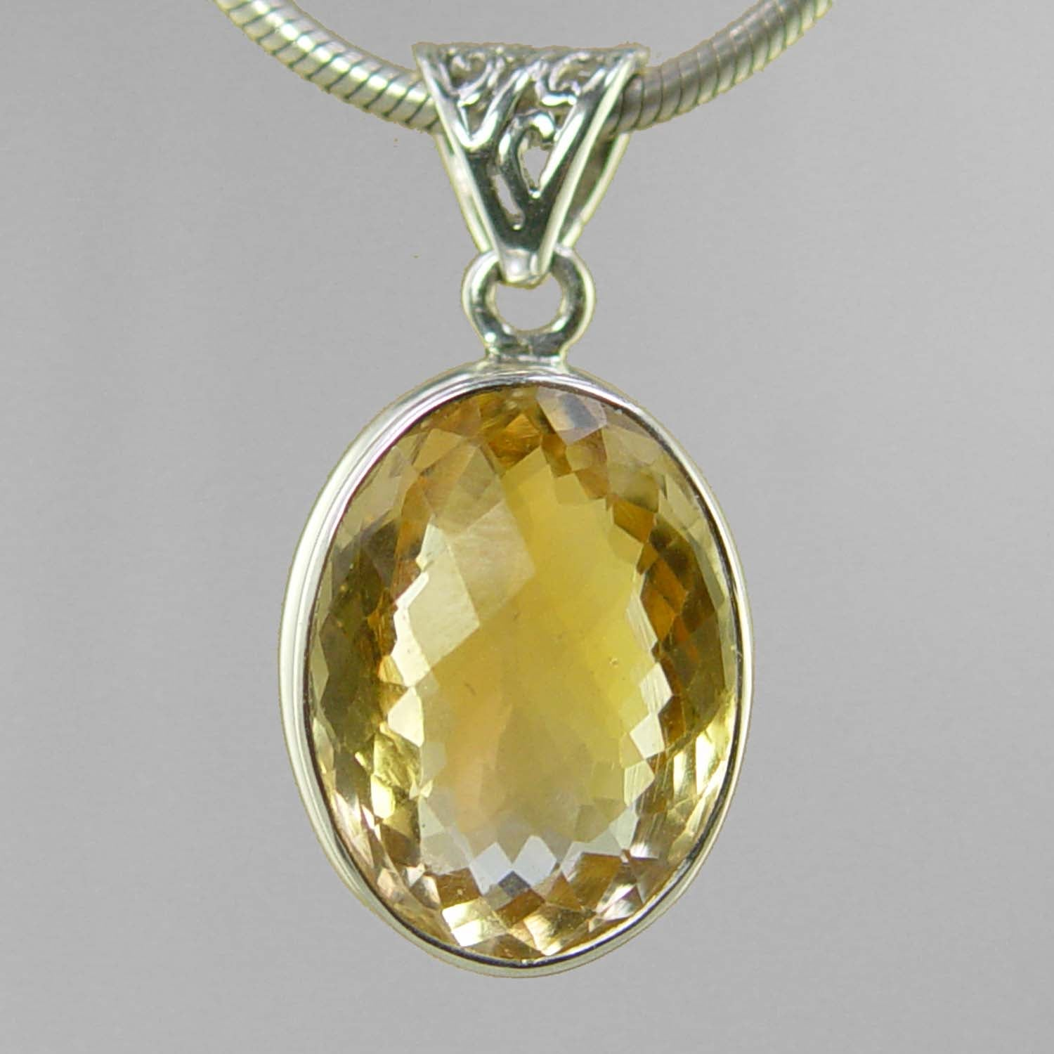 Citrine 12 ct Oval Bezel Set Sterling Silver Pendant