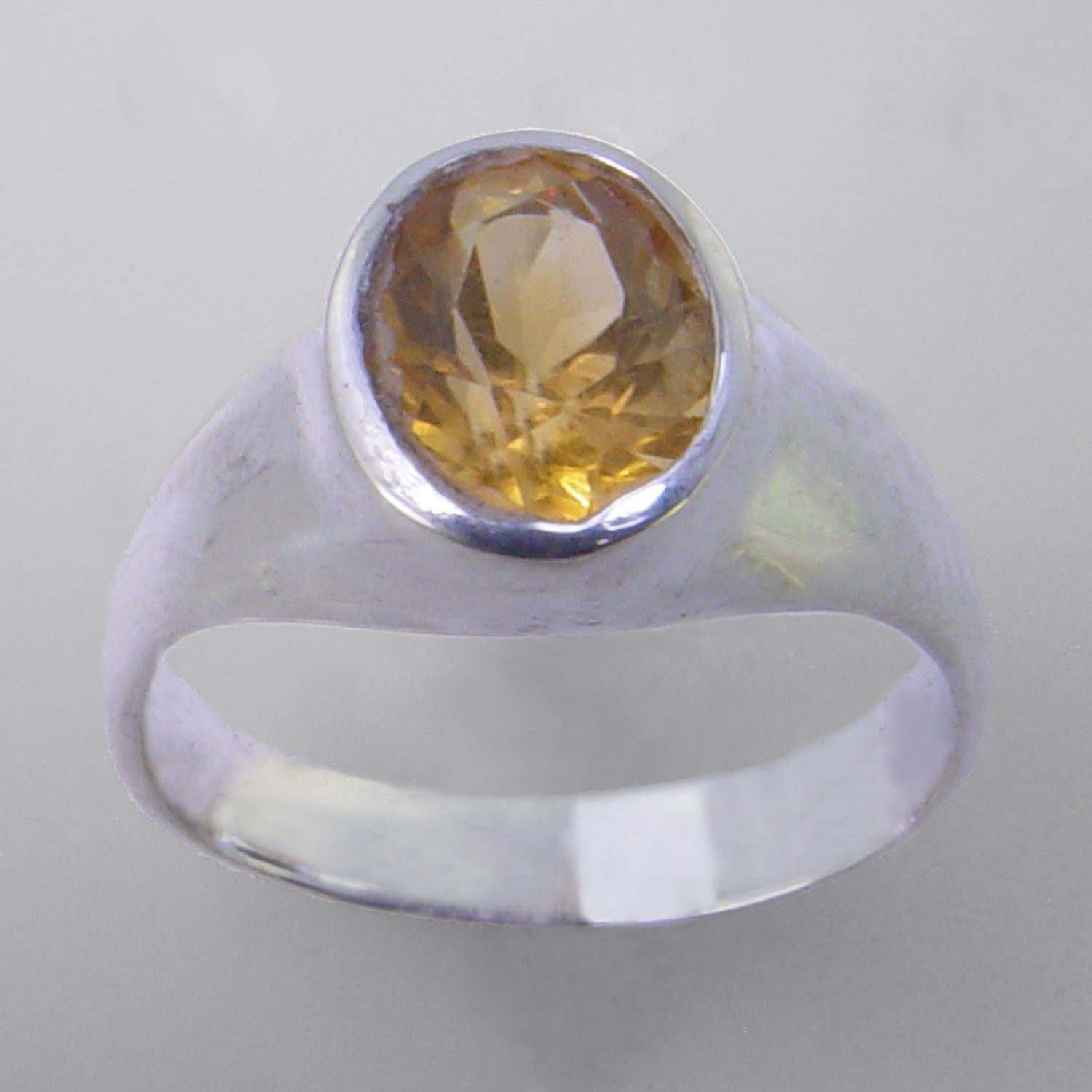 Citrine 2.5 ct Faceted Oval Bezel Set Sterling Silver Ring, Size 10