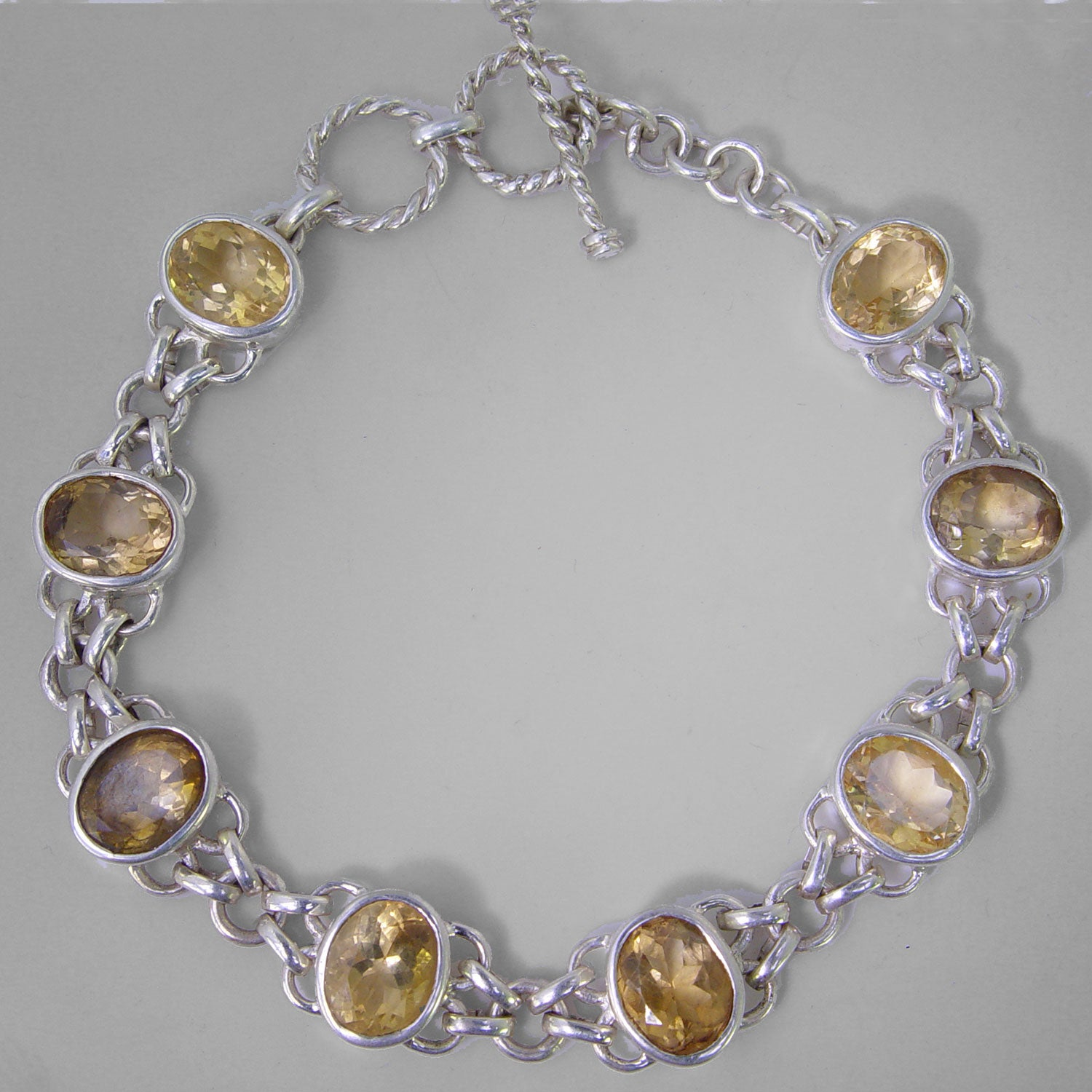 Citrine 8 Faceted Ovals Bezel Set Sterling Silver Link Bracelet - 20 CTW