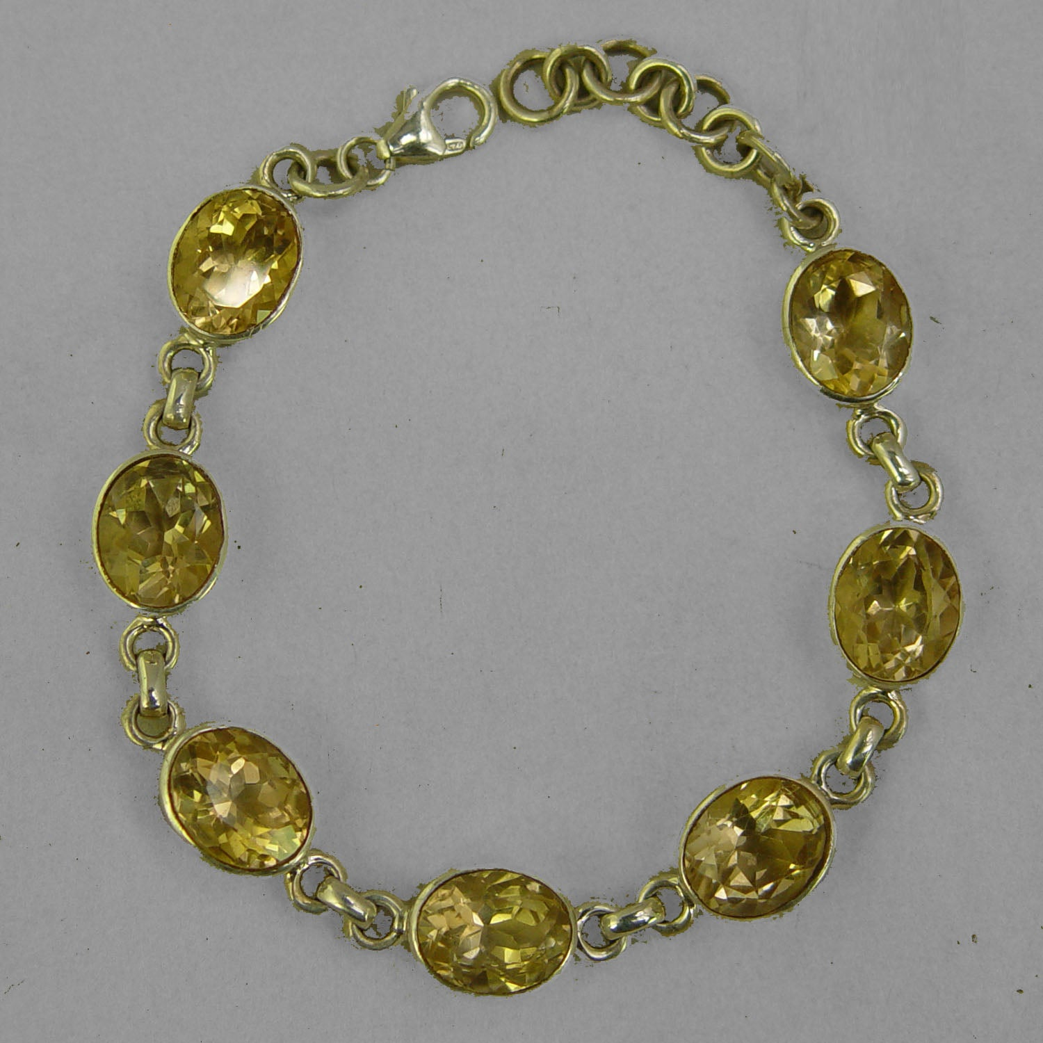 Citrine 7 Faceted Ovals Bezel Set Sterling Silver Link Bracelet - 25 CTW