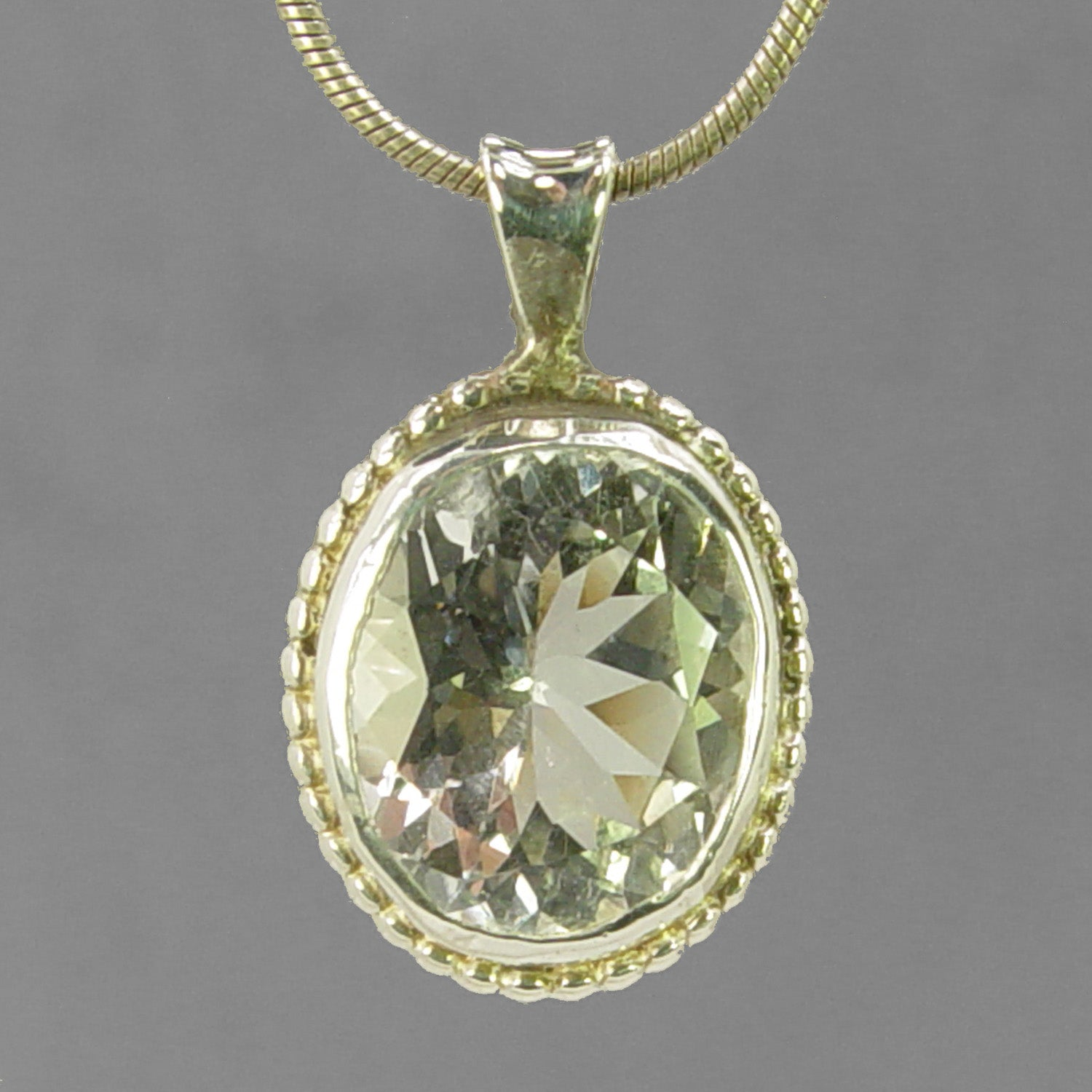 White Topaz 8.15 ct Faceted Oval Fancy Bezel Set Sterling Silver Pendant
