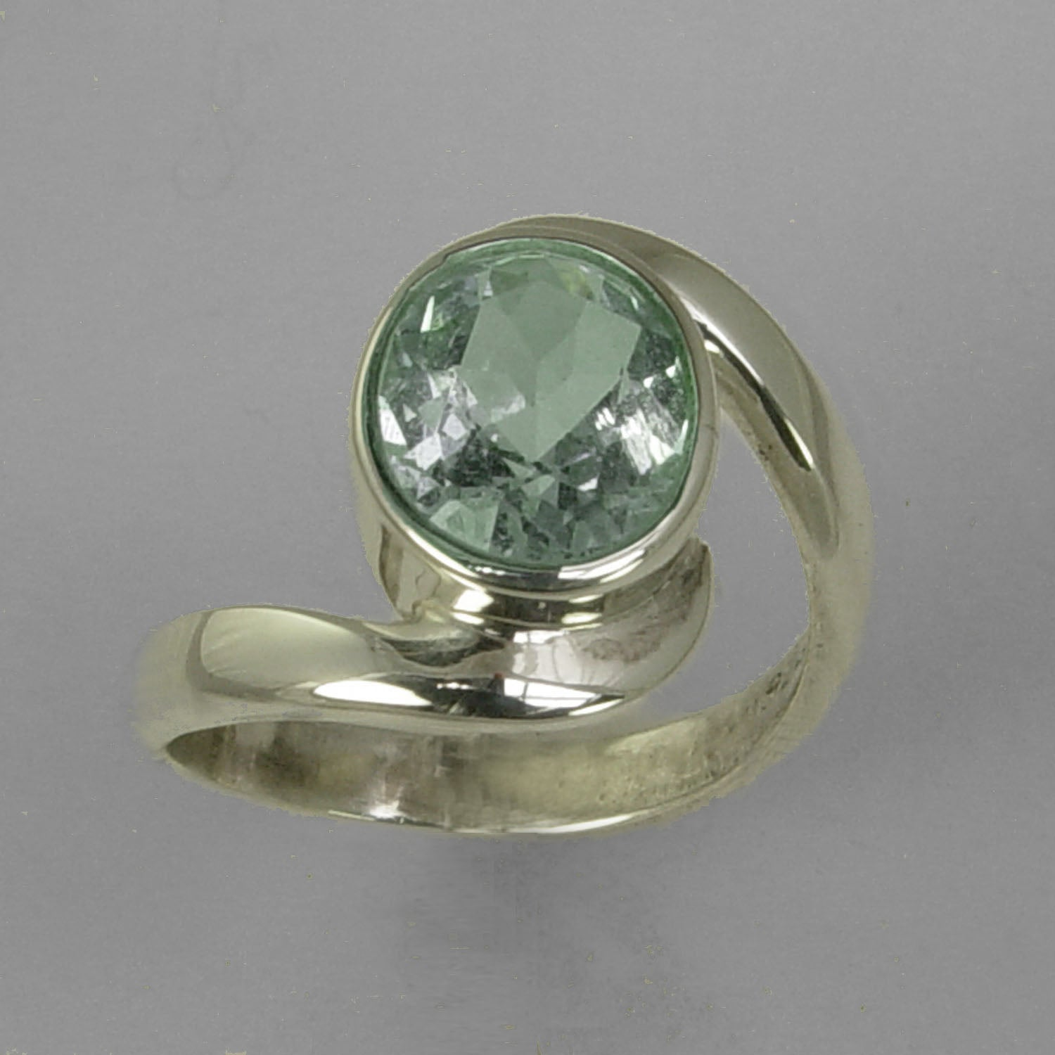 Aquamarine 3 ct Oval Bezel Set Sterling Silver Swirl Shank Ring, Size 8