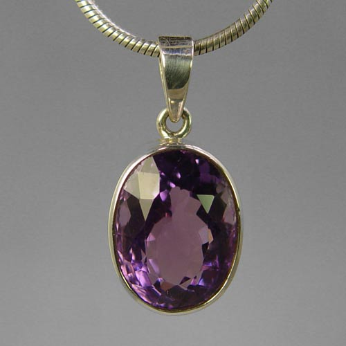Amethyst 13 ct Faceted Oval Bezel Set Sterling Silver Pendant