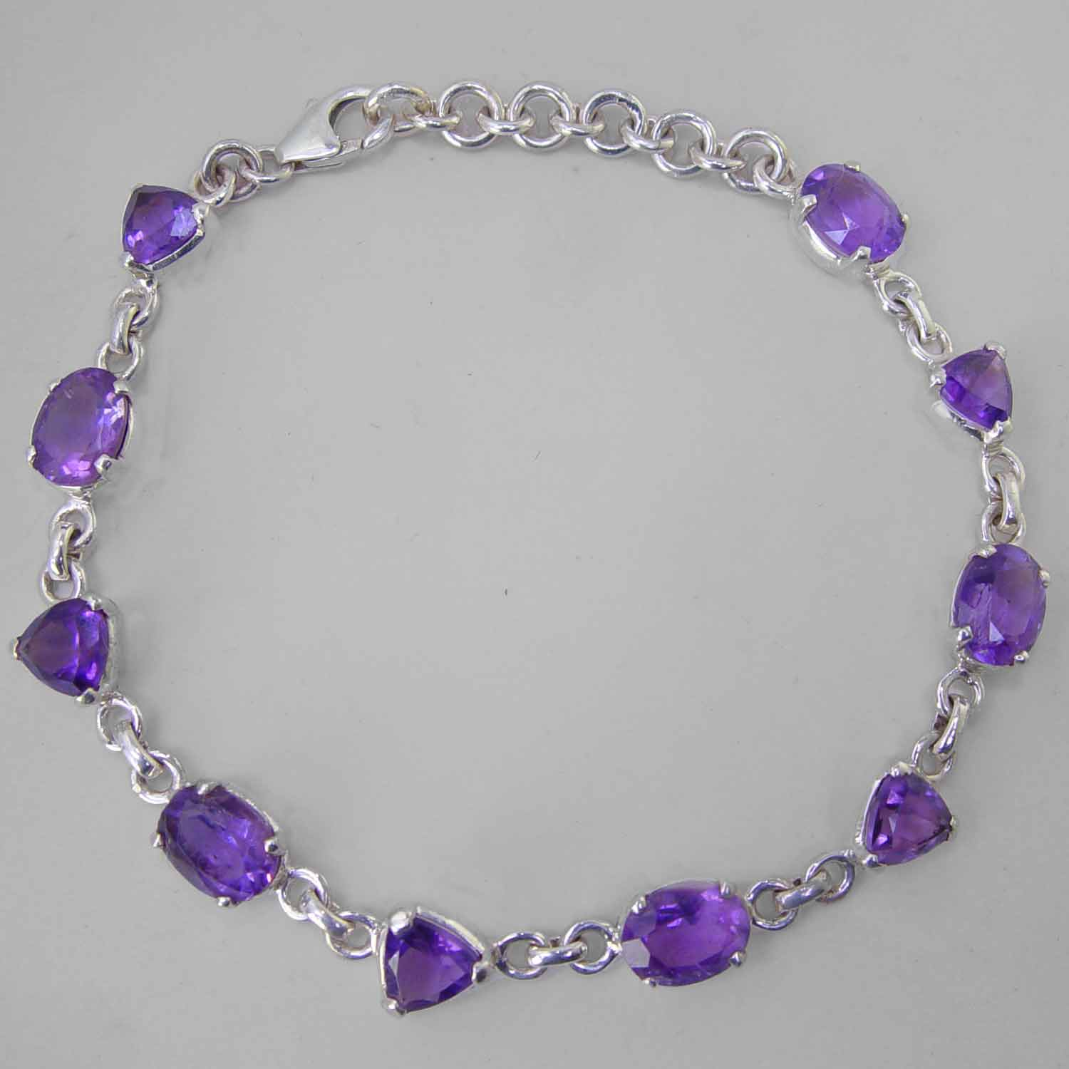 Amethyst Faceted Trillion Cut and Oval Sterling Silver Link Bracelet - 6 CTW