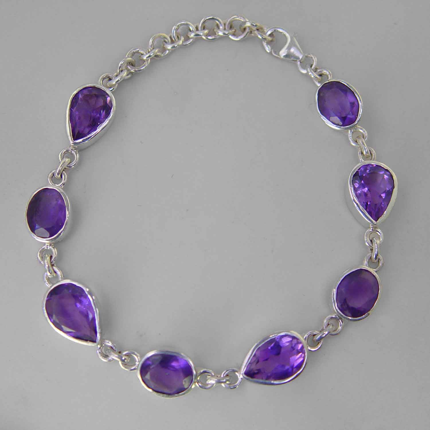 Amethyst Faceted Pear and Oval Bezel Set Sterling Silver Link Bracelet - 19 CTW