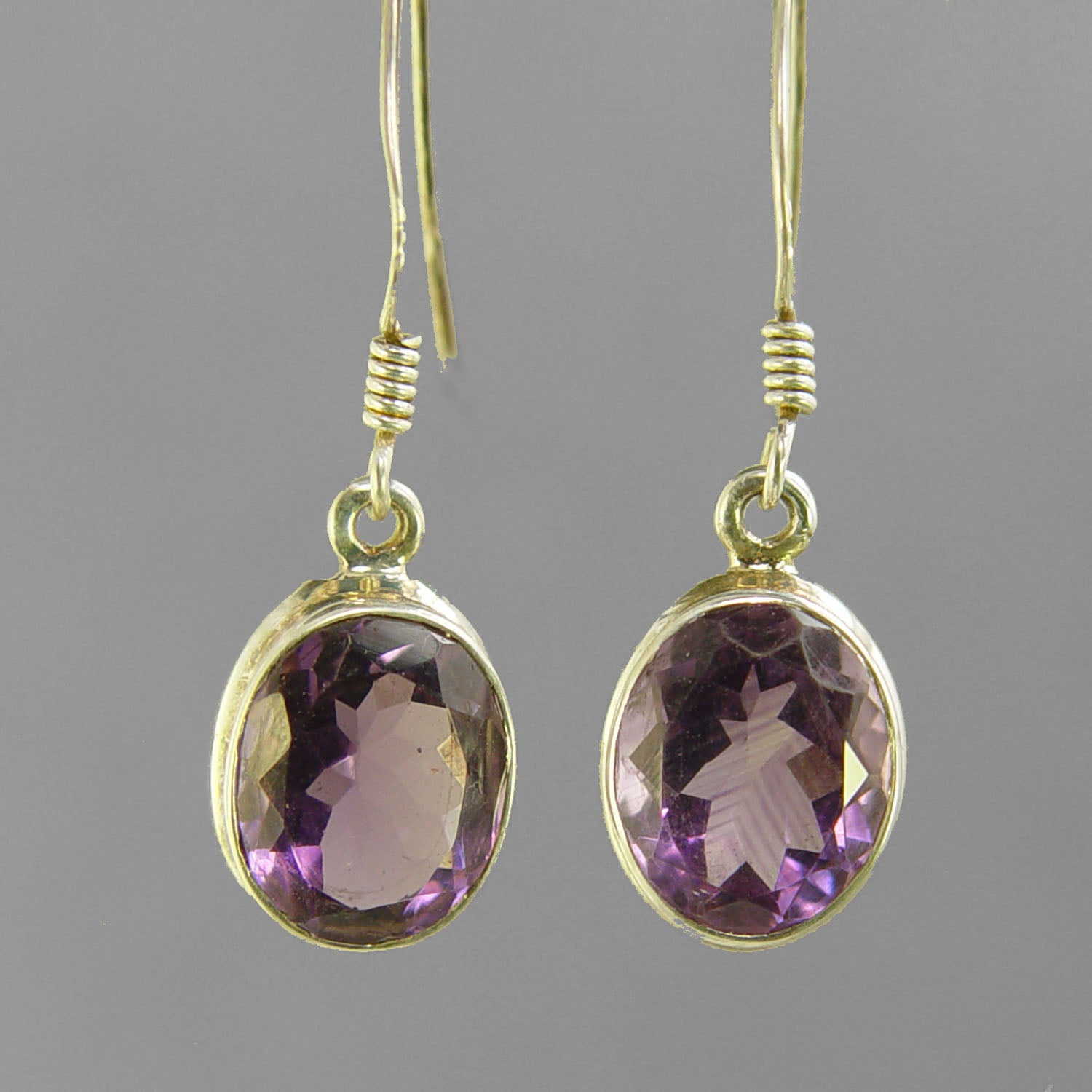 Amethyst Faceted Oval Bezel Set Sterling Silver Earrings - 7 CTW