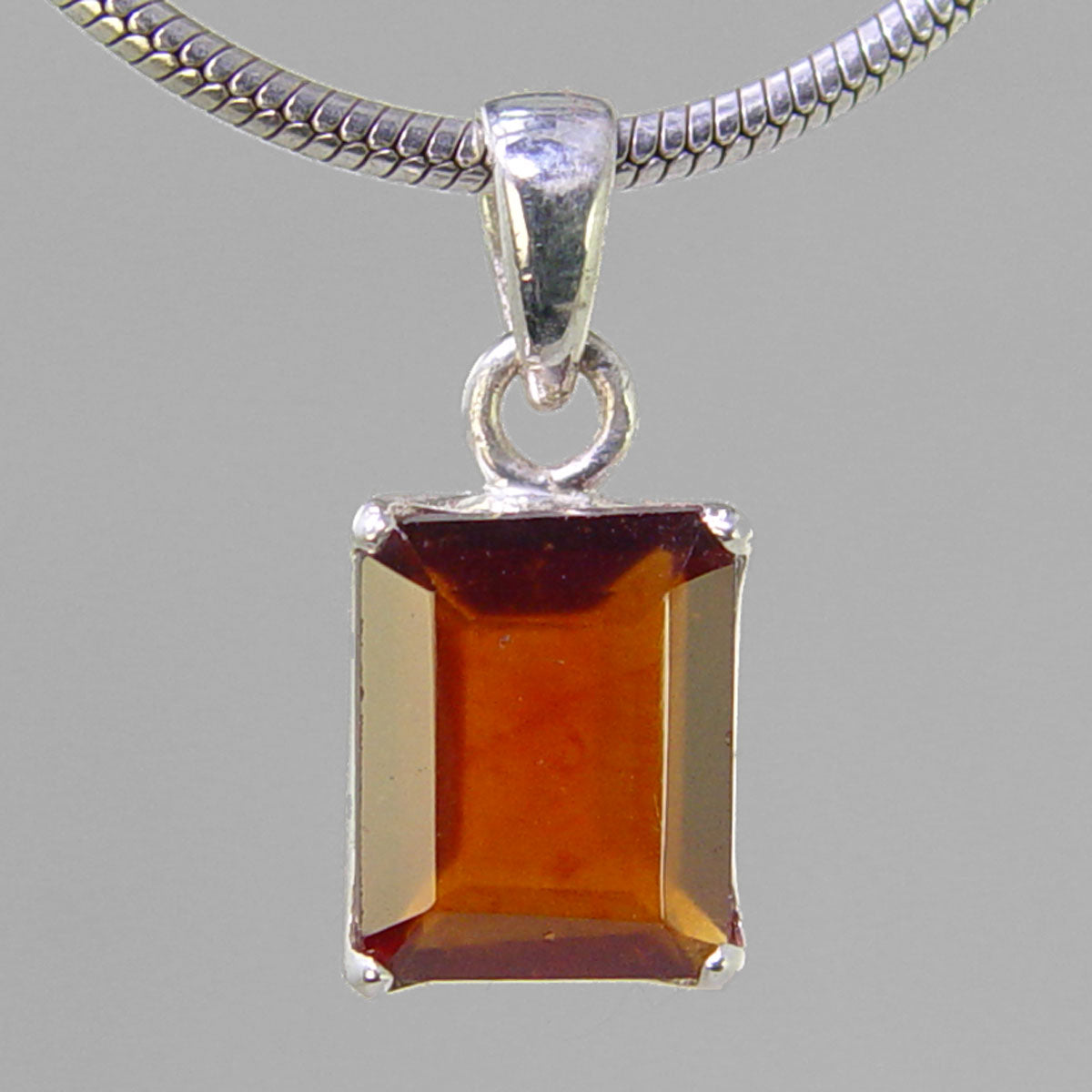 Hessonite Garnet 6.9 ct Faceted Emerald Cut Sterling Silver Pendant