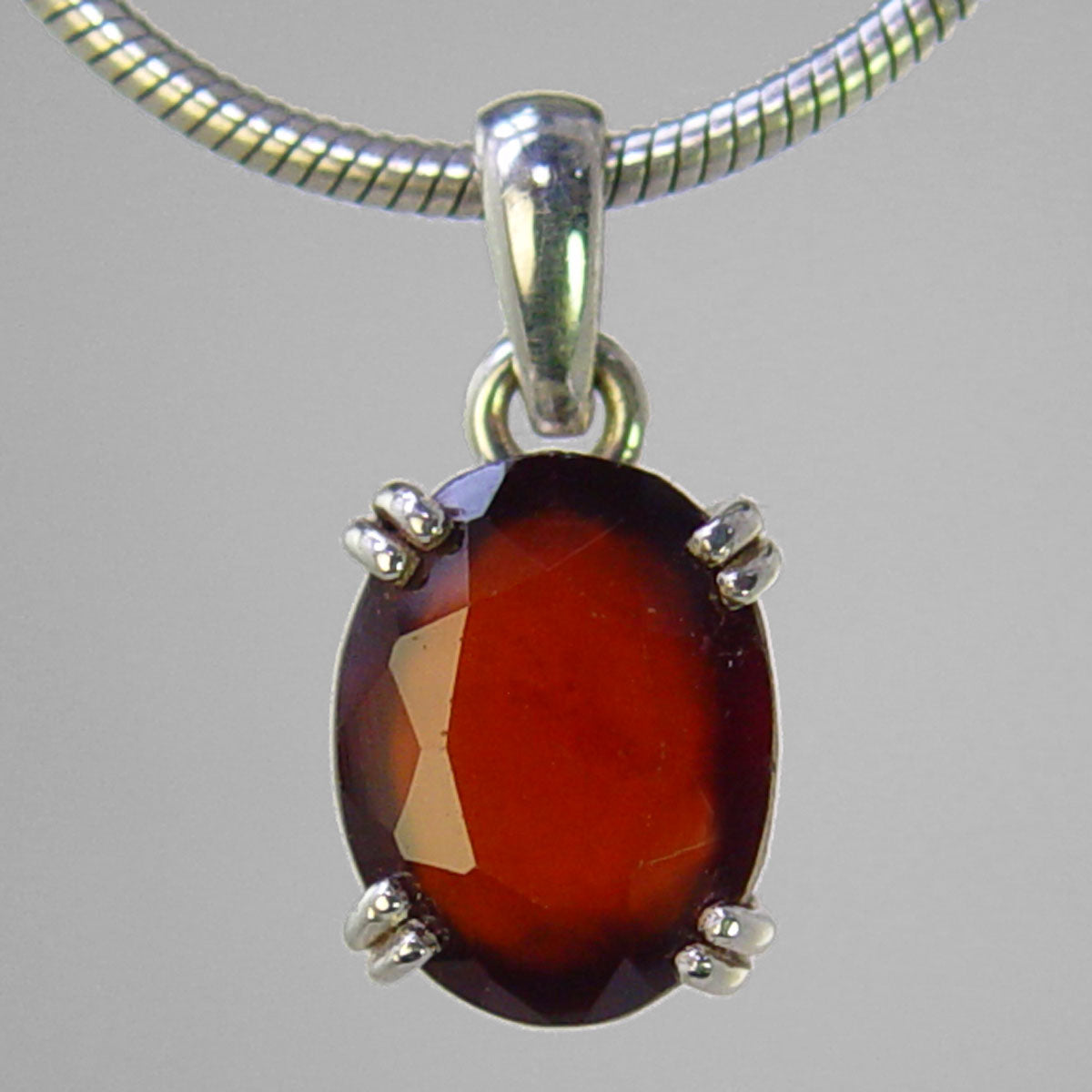 Hessonite Garnet 8.4 ct Faceted Oval Prong Set Sterling Silver Pendant
