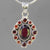 Hessonite Garnet 8 ct Faceted Oval with 12 Side Stones Sterling Silver Pendant