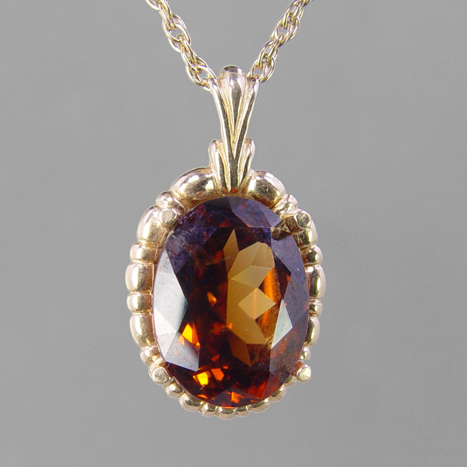 Red Orange Zircon 10 ct Faceted Oval 14KY Gold Pendant