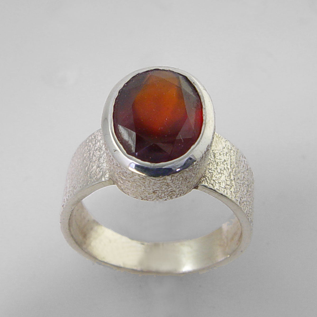 Cinnamon Hessonite Garnet 6.3 ct Faceted Oval Sterling Silver Ring, Size 8