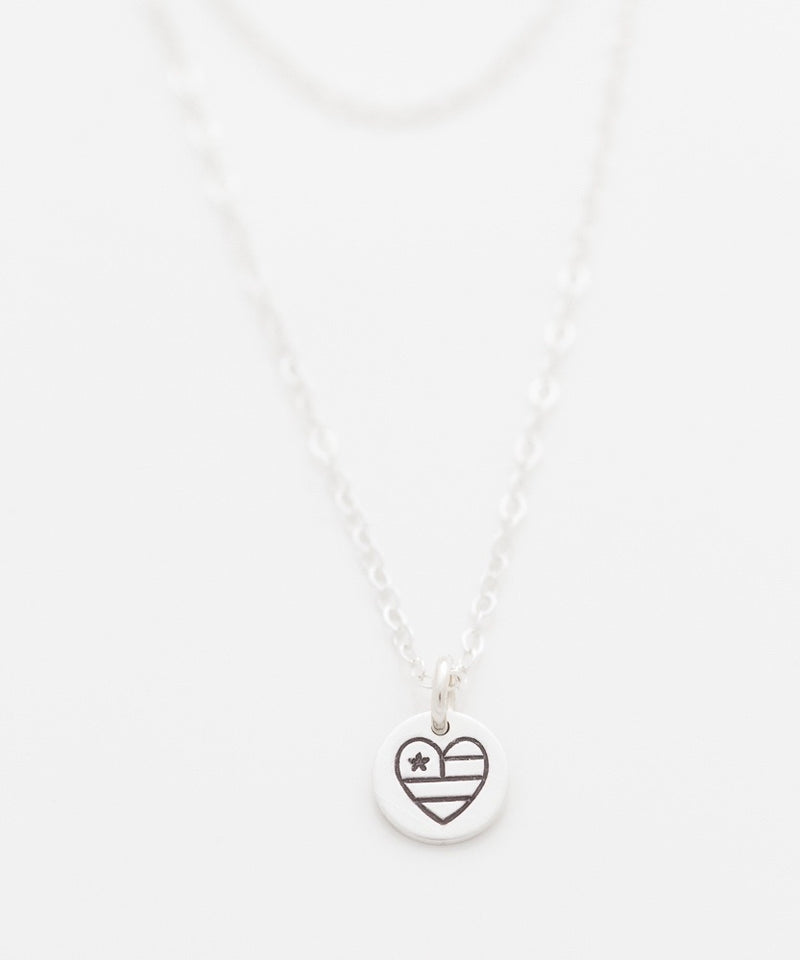 United Hearts tiny coin necklace