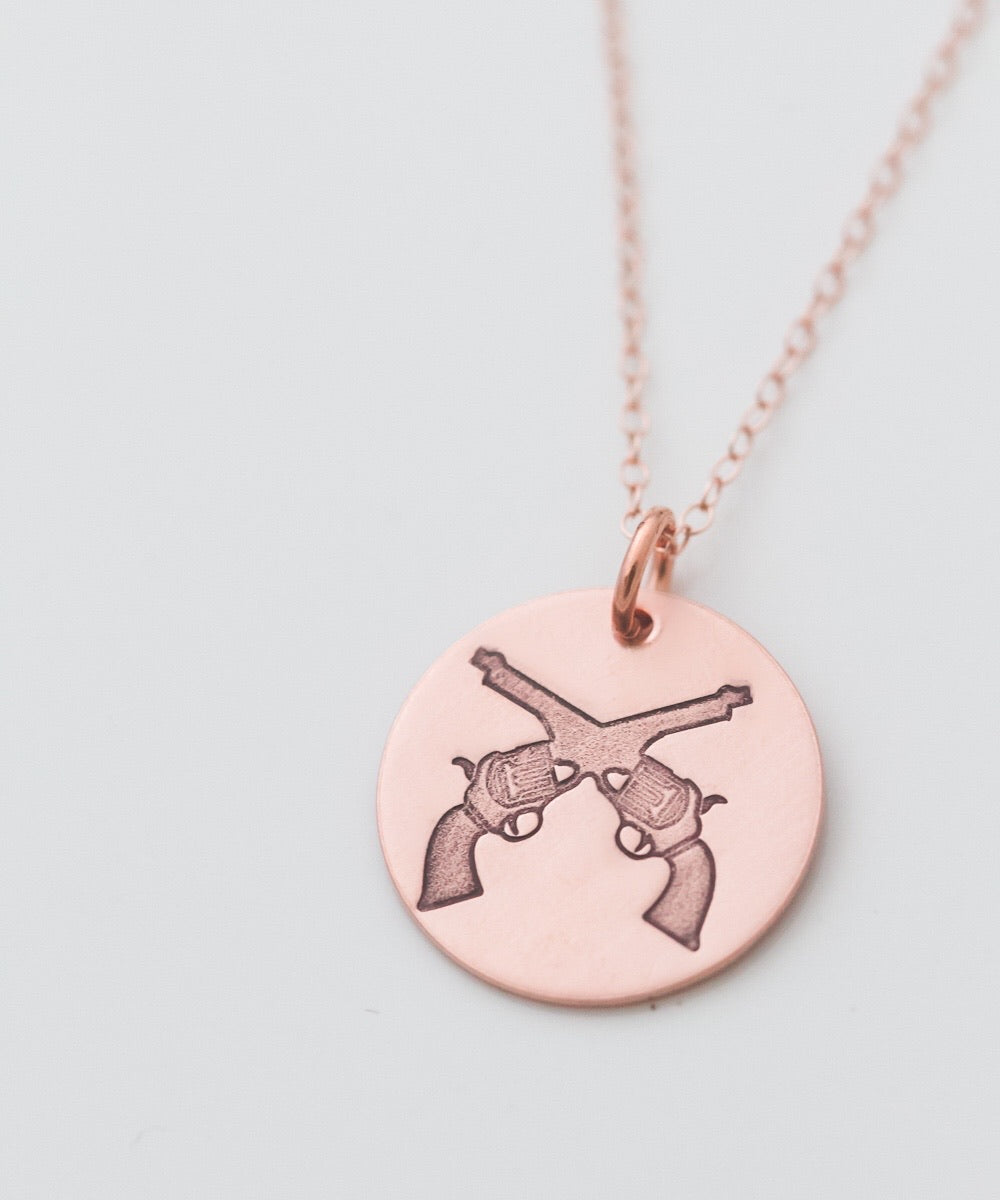 Crossed Revolvers Coin Necklace