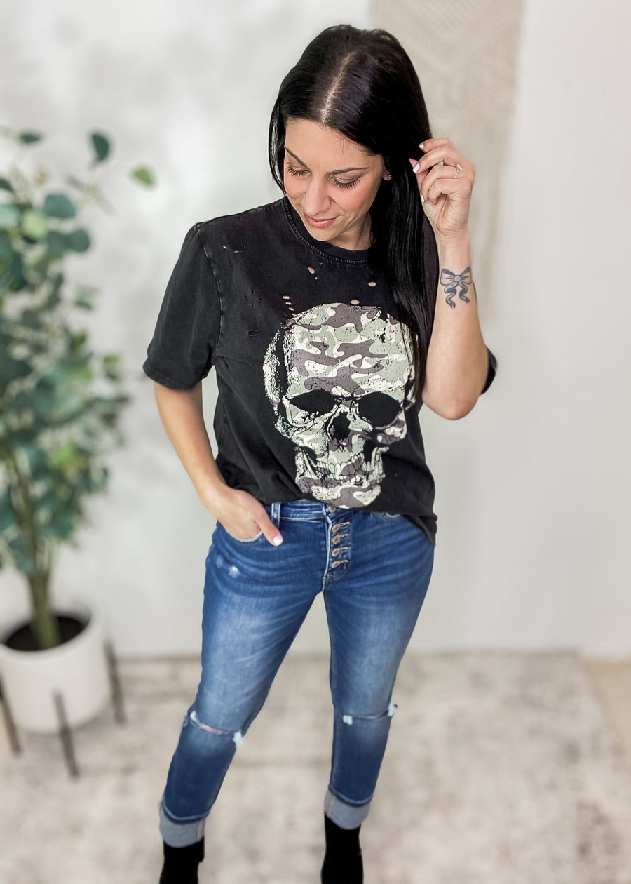 "'Combat' Vintage Black Distressed Camo Skull Tee-The camo filled skull gives this vintage tee even more of an edge! The perfectly placed distressing gives it all the ""favorite worn in tee"" vibes. A black mineral washed fabric gives it a cool & moody look. The washed fabric is soft & comfortable! Black vintage washed tee Hole distressing, Camo filled Skull design.-Cali Moon Boutique, Plainville Connecticut"