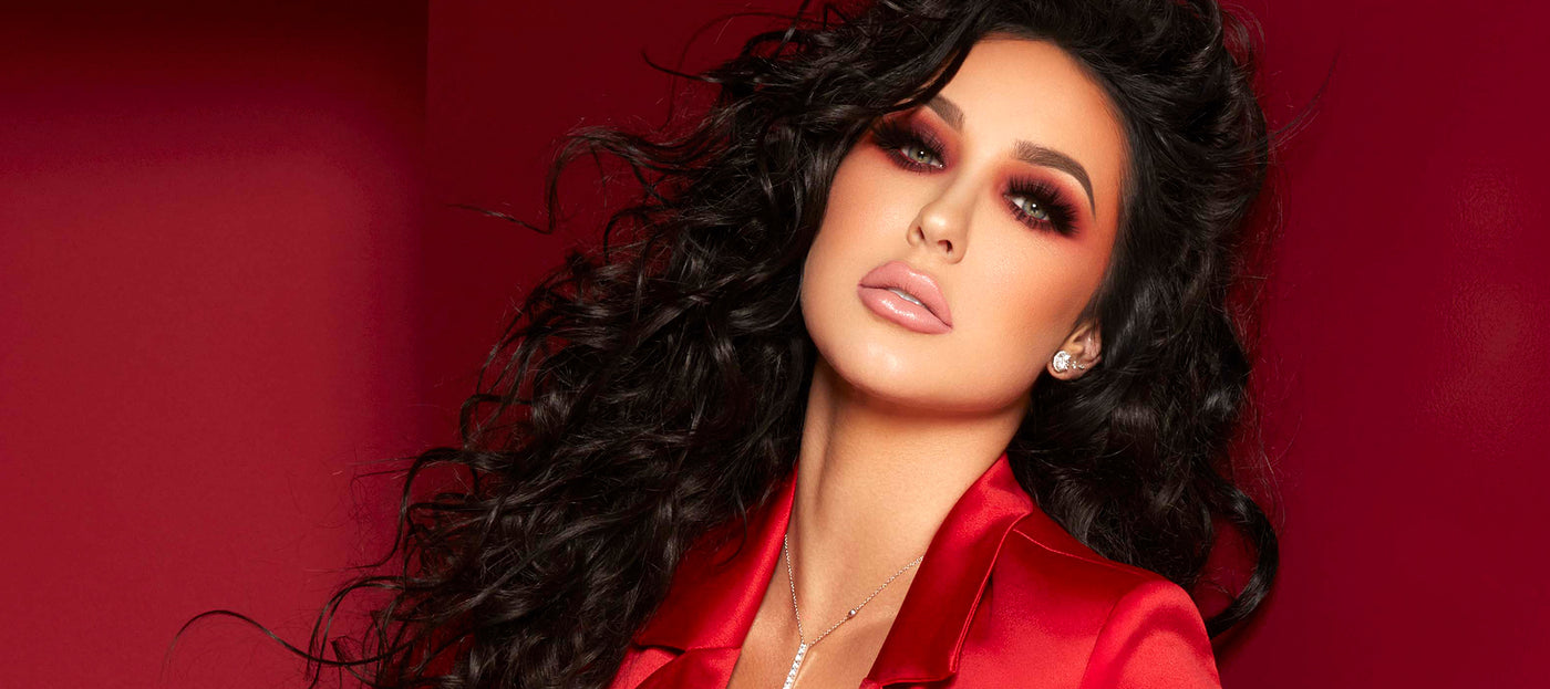 Jaclyn Hill on red background