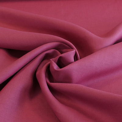 Derry Raspberry Dark Pink 100% Pure Linen Woven Fabric Detail Swirl Image from Patternsandplains.com