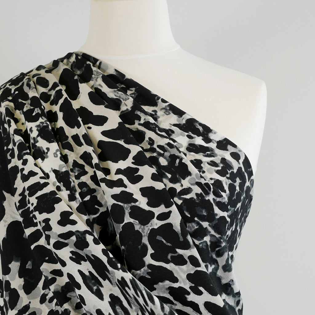 Alton Black and Grey Animal Print Scuba Crepe Fabric Mannequin Closeup Image from Patternsandplains.com