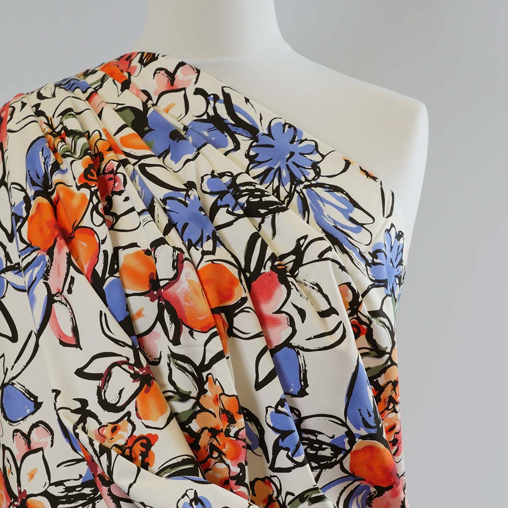 Antibes Brights on Cream, Stretch Cotton Woven Satin Print Fabric Mannequin Closeup Image from Patternsandplains.com