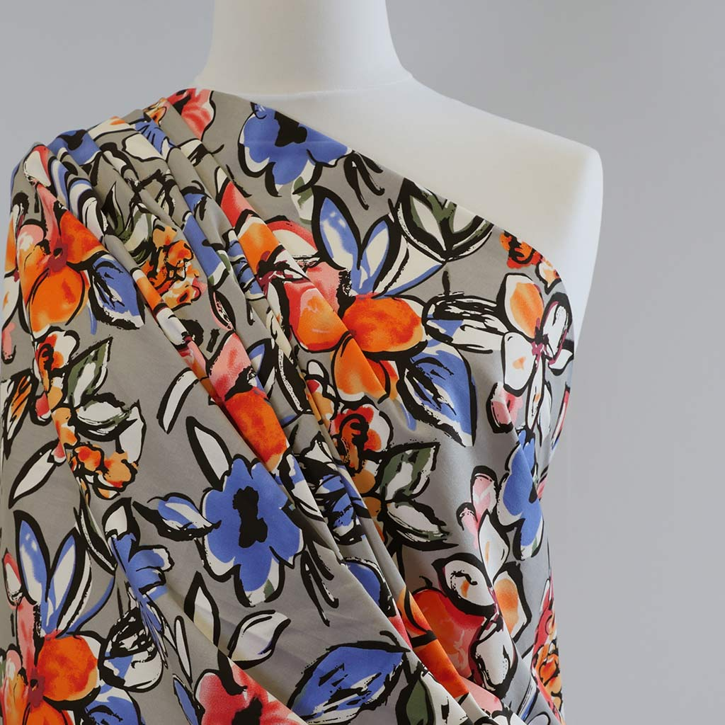 Antibes Brights on Grey, Stretch Cotton Woven Satin Print Fabric Mannequin Closeup Image from Patternsandplains.com