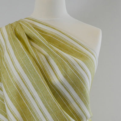 Antrim Vertical Stripe Fresh Kiwi Green White 100% Linen Woven Fabric Mannequin Closeup Image from Patternsandplains.com