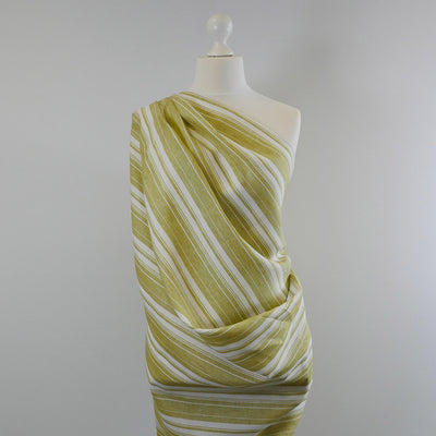 Antrim Vertical Stripe Fresh Kiwi Green White 100% Linen Woven Fabric Mannequin Wide Image from Patternsandplains.com