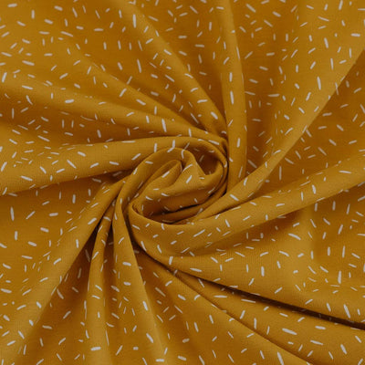 Arizona - Mustard Yellow Ticker Tape, Single Jersey Cotton Elastane Print Fabric Detail Swirl Image from Patternsandplains.com