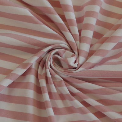 Avalon - Cloudy Pink and White Yarn Dyed Stripe, Single Jersey Cotton Elastane Fabric Detail Swirl Image from Patternsandplains.com