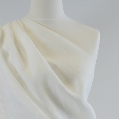 Balla Stripe White Shadow 100% Pure Linen Woven Fabric Mannequin Closeup Image from Patternsandplains.com