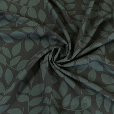 Barbi Crepe 5486 - Petrol and Black, Magnolia Leaves Stretch Woven Crepe Fabric from John Kaldor Detail Swirl Image from Patternsandplains.com