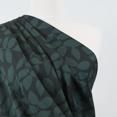 Barbi Crepe 5486 - Petrol and Black, Magnolia Leaves Stretch Woven Crepe Fabric from John Kaldor Mannequin Close Up Image from Patternsandplains.com