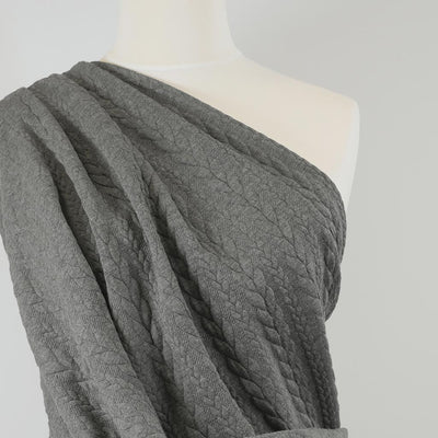 Bergen - Fossil Grey Aran Cables Double Jersey Blister Fabric Mannequin Close Up Image from Patternsandplains.com
