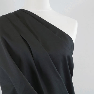 Bermuda - Black Stretch Cotton Woven Twill Fabric Mannequin Close Up Image from Patternsandplains.com
