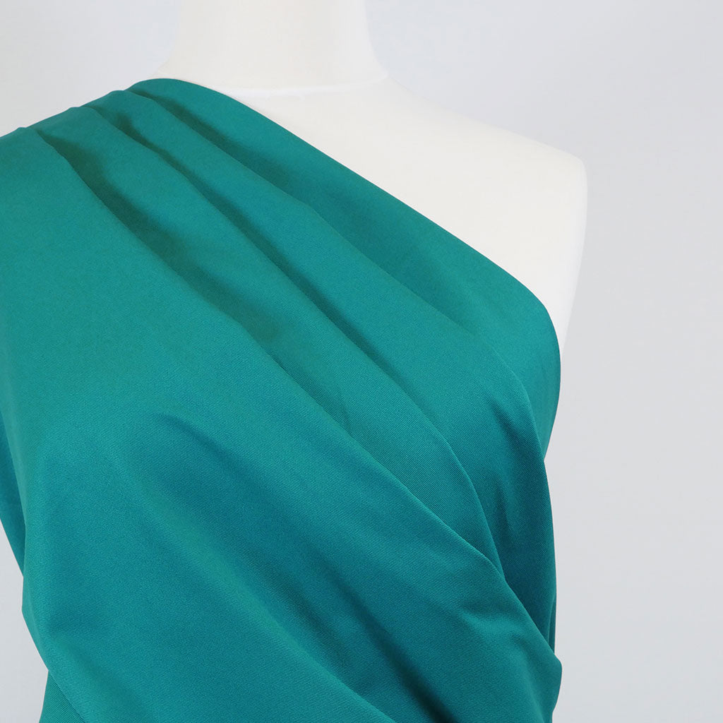 Bermuda - Sea Green Stretch Cotton Woven Twill Fabric Mannequin Close Up Image from Patternsandplains.com