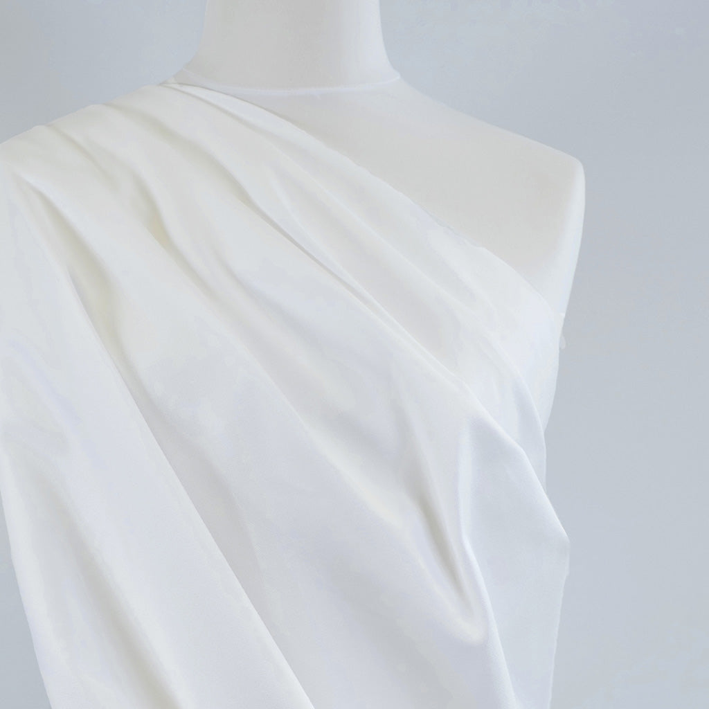 Patternsandplains.com-Bermuda-White-Stretch-Cotton-Woven-Twill-Fabric-Mannequin-Closeup-Image
