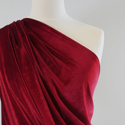 Carlotta Wine Red Stretch Panne Velvet Jersey Fabric from John Kaldor Mannequin Closeup Image from Patternsandplains.com