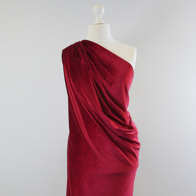 Carlotta Wine Red Stretch Panne Velvet Jersey Fabric from John Kaldor Mannequin Wide Image from Patternsandplains.com