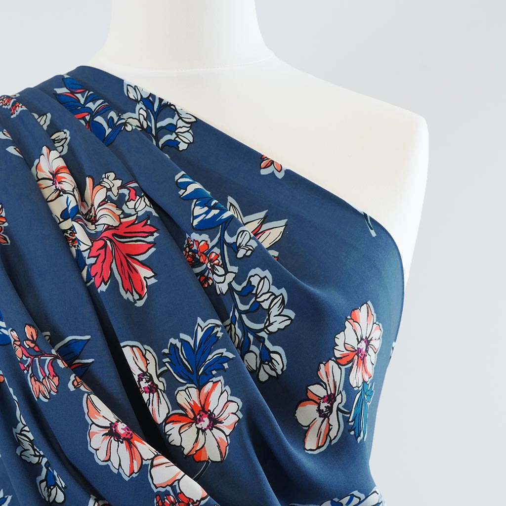 Elbe - Blue, Bright Floral Viscose Lightweight Woven Fabric Mannequin Closeup Image from Patternsandplains.com