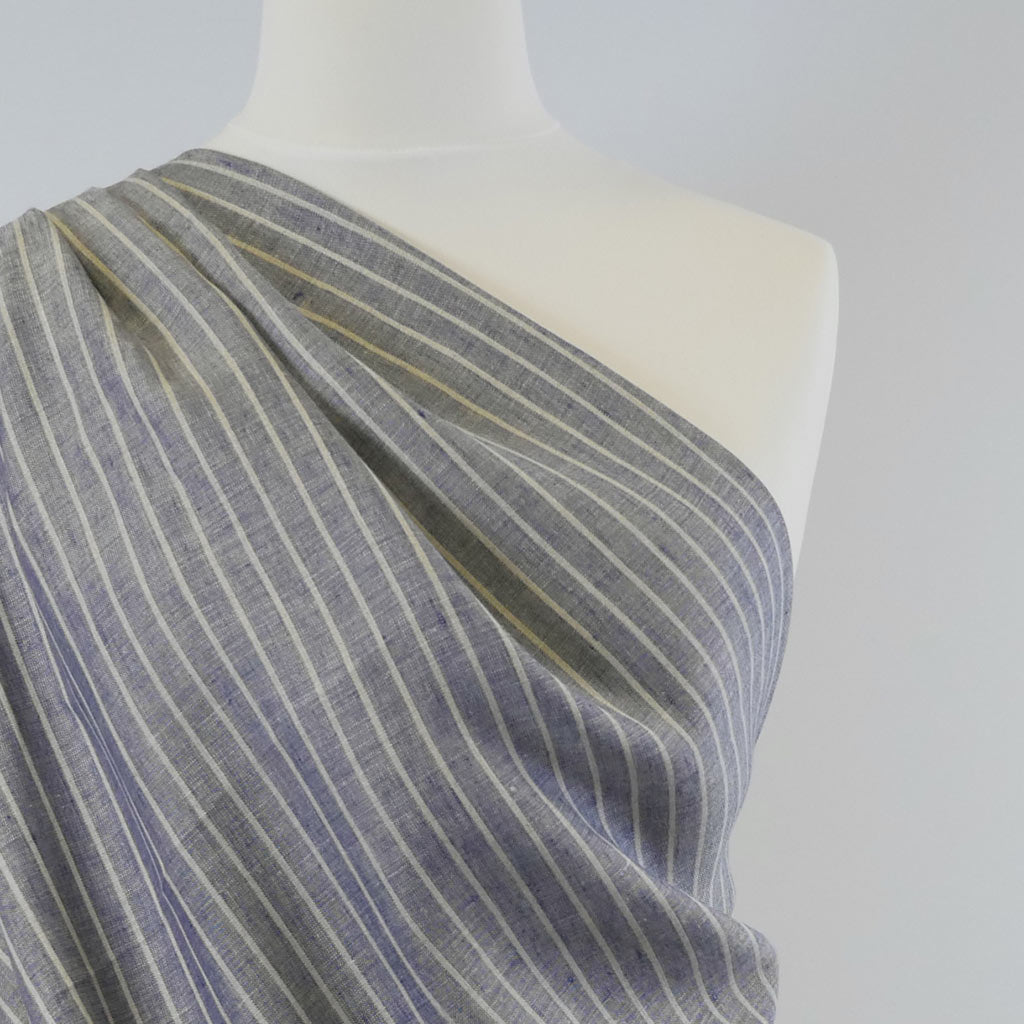 Galway Vertical Stripe Natural and Navy 100% Pure Linen Woven Fabric Mannequin Closeup Image from Patternsandplains.com