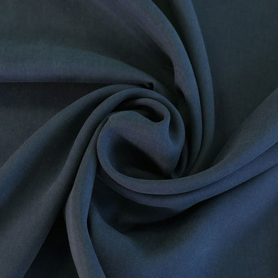 Helsinki - Light Navy Tencel Sandwashed Woven Twill Fabric Detail Swirl Image from Patternsandplains.com