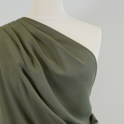 Helsinki - Sage Green Tencel Sandwashed Woven Twill Fabric Mannequin Close Up Image from Patternsandplains.com
