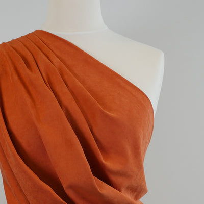 Lincoln Burnt Orange Light Sandwashed Woven Fabric Mannequin Closeup Image from Patternsandplains.com