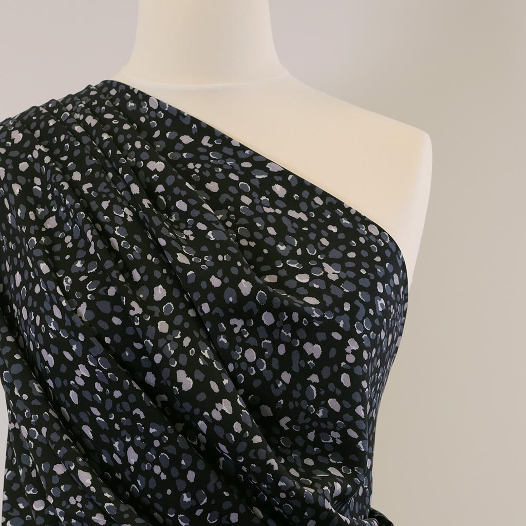 Linz-Black Rain Viscose Woven Twill Fabric Mannequin Closeup Image from Patternsandplains.com