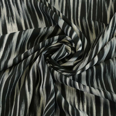 Linz-Black Grey Vertical Viscose Woven Twill Fabric Detail Swirl Image from Patternsandplains.com