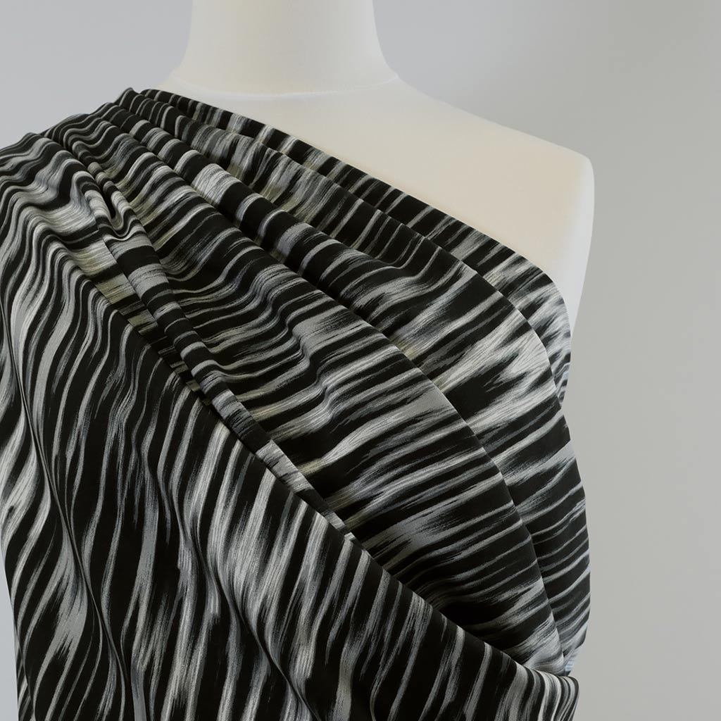 Linz-Black Grey Vertical Viscose Woven Twill Fabric Mannequin Closeup Image from Patternsandplains.com