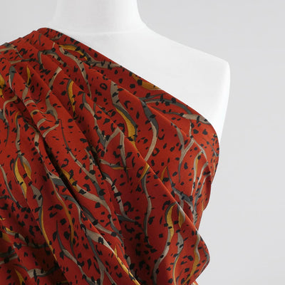 Linz- Cayenne Red Wild Elements Viscose Woven Twill Fabric Mannequin Close Up Image from Patternsandplains.com