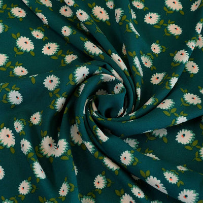 Loire Green Double Daisies Viscose Crepe Fabric Detail Swirl Image from Patternsandplains.com