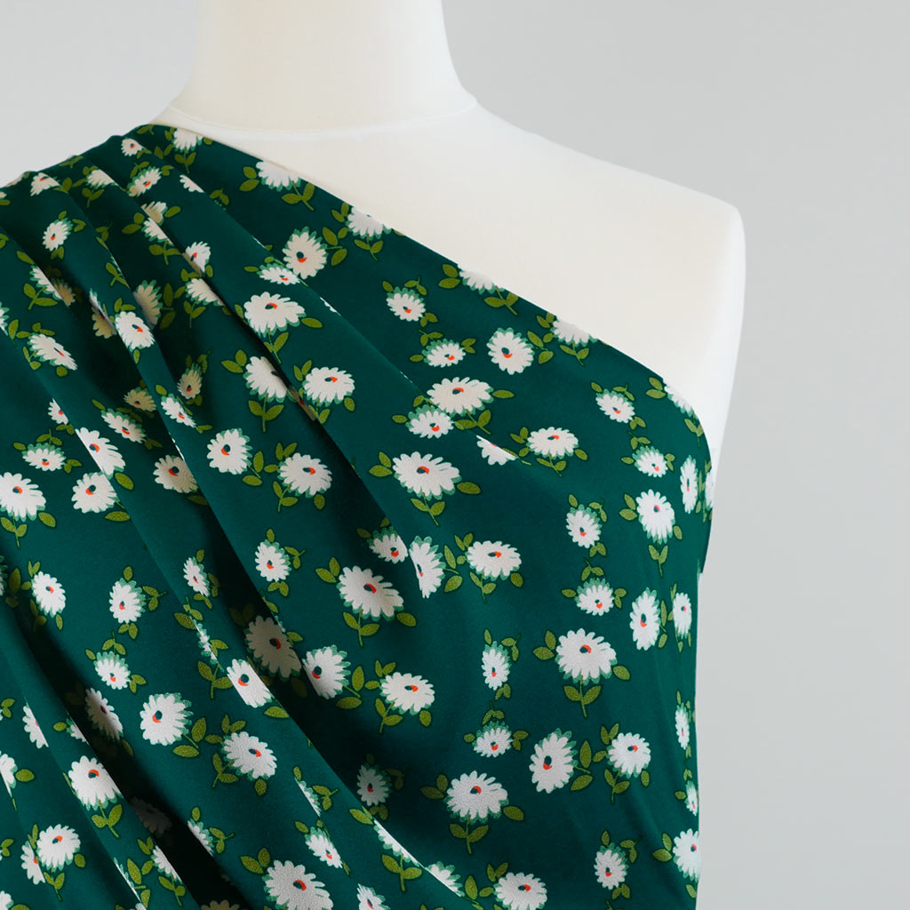 Loire Green Double Daisies Viscose Crepe Fabric Mannequin Closeup Image from Patternsandplains.com