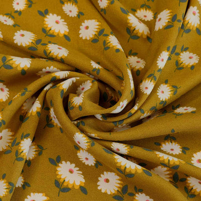 Loire Ochre Double Daisies Viscose Crepe Fabric Detail Swirl Image from Patternsandplains.com